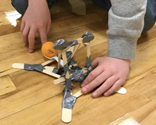 Makers turned sticks, tape and spoons into ping pong ball catapults.