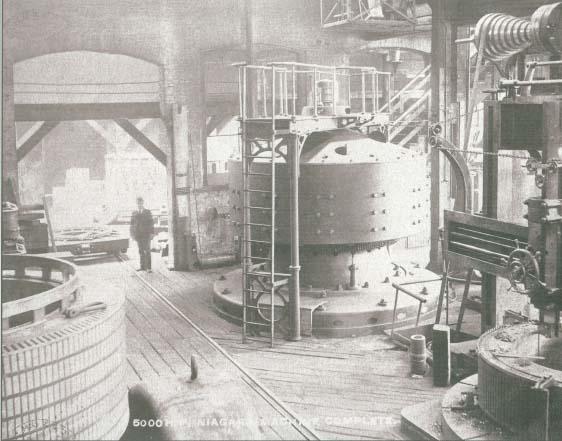 Nikola Tesla designed A/C turbines at Niagara. First large hydro power station.